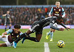 Tyrone Mings of Aston Villa fouls Ricardo Pereira of Leicester City during the Premier League match at Villa Park, Birmingham. Picture date: 8th December 2019. Picture credit should read: Darren Staples/Sportimage