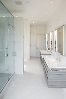This cleanly designed bathroom integrate lighting and audio control for conveniences at all locations in your home.
