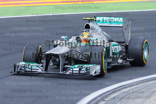 Petronas Mercedes F1 Formula One driver Lewis Hamilton of Great Britain drives his car during the qualifier of the Hungarian F1 Grand Prix in Mogyorod (about 20km north-east from capital city Budapest), Hungary on July 27, 2013. ATTILA VOLGYI