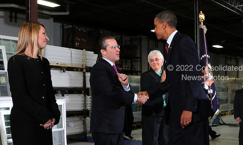 United States President Barack Obama, left, introduces his new economic team at the Thompson Creek Manufacturing Company in Landover, Maryland on Friday, January 7,2011. He announced the appointment of  Gene B. Sperling, right, to be the Director of the National Economic Council. From left to right: Heather Higginbottom, Deputy Director Office of Management and Budget; Gene B. Sperling; and Katharine Abraham, Member of the Council of Economic Advisors.  ISP pool photo by Dennis Brack/Black Star.Credit: Dennis Brack / Pool via CNP