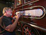 Volunteer Loren Jahn works on hand-painted lettering on the Glenbrook locomotive at the Nevada State Railroad Museum in Carson City, Nev., on Friday, Dec. 12, 2014. Jahn remembers seeing the Glenbook as a child and says it sparked his lifelong love of trains. (Las Vegas Review-Journal/Cathleen Allison)