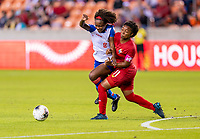 HOUSTON, TX - FEBRUARY 3: Dany Etienne #8 of Haiti collides with Marta Cox #11 of Panama during a game between Panama and Haiti at BBVA Stadium on February 3, 2020 in Houston, Texas.