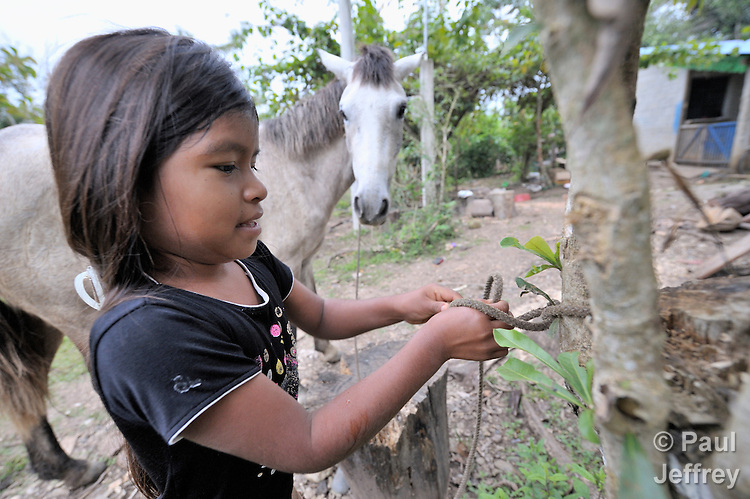 A girl ties up her horse in Victoria 20 de enero, a village of former Guatemalan refugees in Mexico who returned home as a group in 1993, while the country's bloody civil war still raged.