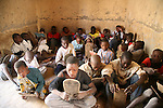 Pupils learn Coran by reading versets written on wooden boards. The teaching room is a simple room at the entrance of the house of the marabout.  The coranic schools in Timbuctu are only open early in the morning and on Saturdays in order to allow pupils to attend the public school.