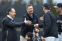 John Zeglinski (left) and Kyle Sleeth (center) shake hands with Wake Forest Demon Deacons head coach Tom Walter (16) prior to the start of the NCAA baseball game against the Illinois Fighting Illini at David F. Couch Ballpark on February 16, 2019 in  Winston-Salem, North Carolina.  The Fighting Illini defeated the Demon Deacons 5-2. (Brian Westerholt/Four Seam Images)