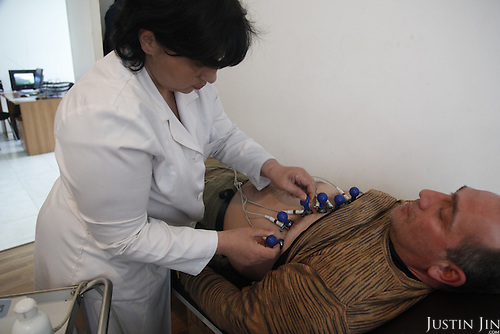 At a clinic, sponsored by Oxfam, in Zugdidi, Georgia, a doctor tends to a patient with heart problems. The patient is an IDP (internally displaced person), displaced by the border war with Abkhazia during  the breakup of the Soviet Union in the early 1990s.