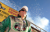 Nov 14, 2010; Pomona, CA, USA; NHRA funny car driver John Force celebrates after clinching the 2010 funny car championship during the Auto Club Finals at Auto Club Raceway at Pomona. Mandatory Credit: Mark J. Rebilas-