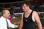 02/26/11--Oregon City wrestling head coach Roger Rolen congratulates Jared Groner for his win over Barlow's John Wolfe in the 285 lb. weight division of the 6A wrestling state championship at the Memorial Coliseum..Photo by Jaime Valdez......................................