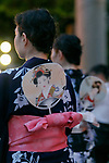 Visitors dressed in traditional Japanese clothing dance during the annual ''Mitama Festival'' at Yasukuni Shrine on July, 13, 2017, Tokyo, Japan. Over 30,000 lanterns are displayed along the entrance of the shrine to help spirits find their way during the annual celebration for the spirits of ancestors. The festival runs until July 16th. (Photo by Rodrigo Reyes Marin/AFLO)