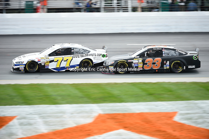 September 21, 2014 - Loudon, New Hampshire, U.S. -  Sprint Cup Series driver David Stremme (33) makes contact with driver Corey Lajoie (77) during the Nascar Sprint Cup Series Sylvania 300 race held at the New Hampshire Motor Speedway in Loudon, New Hampshire.   Eric Canha/CSM