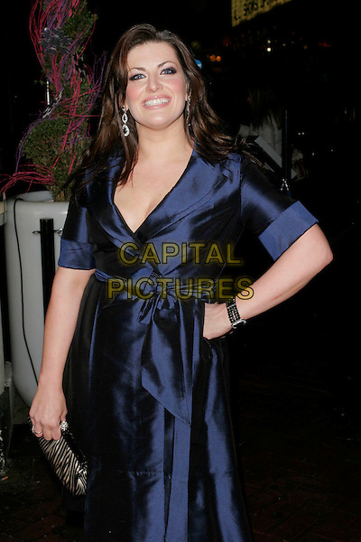 "JODIE PRENGER.The After Party for ""Clubbed"" Gala Screening at Ruby Blue in Leicester Square, London, England..January 7th 2009.half length blue dress hand on hip wrap silk sash belted clutch bag purse .CAP/AH.©Adam Houghton/Capital Pictures."