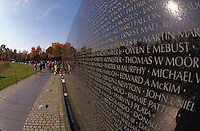 The Vietnam Veteran's Memorial, showing names of the dead etched into the black granite wall. Memorials, Monuments, National Parks, Veterans. Washington District of Columbia USA the Mall.