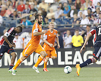 Houston Dynamo midfielder Adam Moffat (16) on the attack.  In a Major League Soccer (MLS) match, Houston Dynamo (orange) defeated the New England Revolution (blue), 2-1, at Gillette Stadium on July 13, 2013.