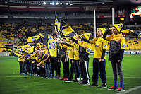 Kids welcome the teams to the field during the Super Rugby semifinal match between the Hurricanes and Chiefs at Westpac Stadium, Wellington, New Zealand on Saturday, 30 July 2016. Photo: Dave Lintott / lintottphoto.co.nz