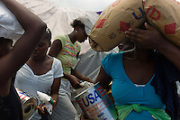 Port au Prince, Haiti, April 12, 2010.The last large 'blanket food distribution' by WFP in the large IDP camp near Cité Soleil. In the future, food distributions will be targeted to specific target groups. The 3 months anniversary of the earthquake, as the rainy season arrives making life conditions for 2 millions homeless Haitians miserable.