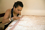 Woman curator repairing mosaic, Archaeological museum, Rhodes, Greece