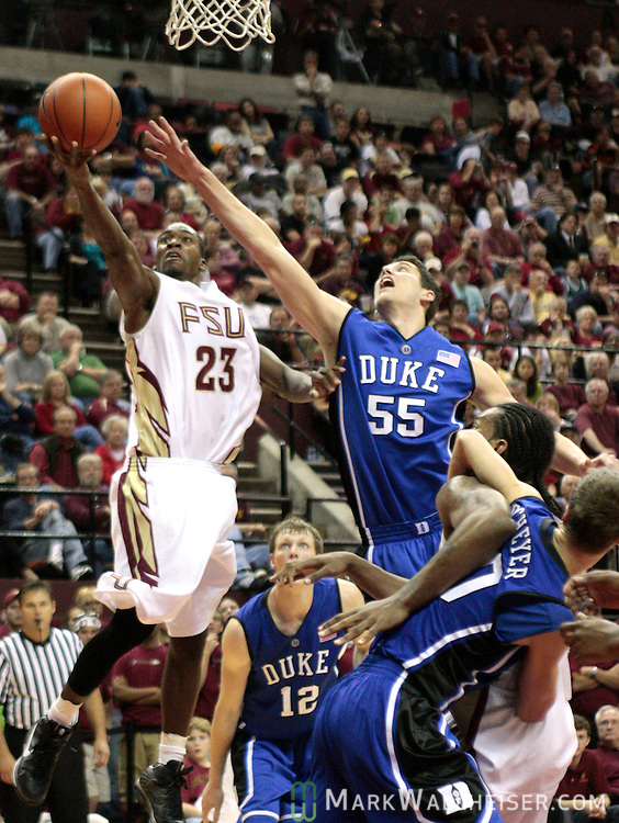 Florida State guard Toney Douglas (23) lays the ball up past Duke center Brian Zoubek (55) in the second half of their NCAA basketball game between Duke and Florida State in Tallahassee January 10, 2009.   (Mark Wallheiser/TallahasseeStock.com)