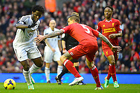 Sunday, 23 February 2014<br /> Pictured: Swansea City's Wilfried Bony takes on Liverpool's Daniel Agger<br /> Re: Barclay's Premier League, Liverpool FC v Swansea City FC v at Anfield Stadium, Liverpool Merseyside, UK.