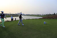 Marcel Siem (GER) and Alexander Levy (FRA) walk onto the 18th tee all square during Sunday's Final Round of the 2014 BMW Masters held at Lake Malaren, Shanghai, China. 2nd November 2014.<br /> Picture: Eoin Clarke www.golffile.ie