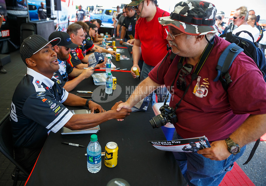 Jun 10, 2017; Englishtown , NJ, USA; NHRA top fuel driver Antron Brown (left) greets fans during qualifying for the Summernationals at Old Bridge Township Raceway Park. Mandatory Credit: Mark J. Rebilas-USA TODAY Sports