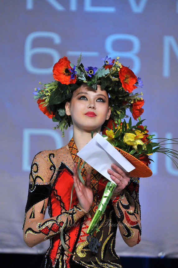 """ALINA MAKSYMENKO of Ukraine celebrates with headdress crown for  winning silver in All Around at 2011 World Cup Kiev, """"Deriugina Cup"""" in Kiev, Ukraine on May 7, 2011."""
