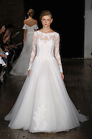 """Model walks runway in a """"Love"""" bridal gown from the Alyne by Rita Vinieris Fall 2017 collection on October 7th, 2016 during New York Bridal Fashion Week."""