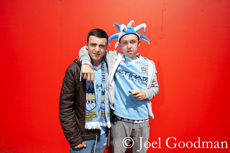 © Joel Goodman - 07973 332324 . 13/05/2012 .  Manchester , UK . Manchester City Football Club fans in Manchester City Centre ahead of an MCFC match against QPR , the result of which determines Manchester City winning the Premiership title . Photo credit: Joel Goodman