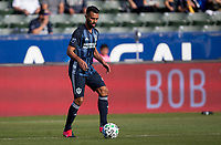 CARSON, CA - FEBRUARY 15: Giancarlo Gonzalez #21 of the Los Angeles Galaxy moves with the ball during a game between Toronto FC and Los Angeles Galaxy at Dignity Health Sports Park on February 15, 2020 in Carson, California.