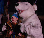 Kentucky Special Olympian Levi Collins poses with a polar bear at the polar plunge in Lexington, Ky., on Thursday, Nov. 14, 2013. Photo by Mike Brassfield | Staff