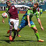 Colorado Rapids Edson Buddle, left,  kicks the ball while being guarded by Seattle's Chad Marshall during an MLS match on April 26, 2014 in Seattle, Washington.  The Seattle Sounders beat the Colorado Rapids 4-1.  Jim Bryant Photo. ©2014. All Rights Reserved.