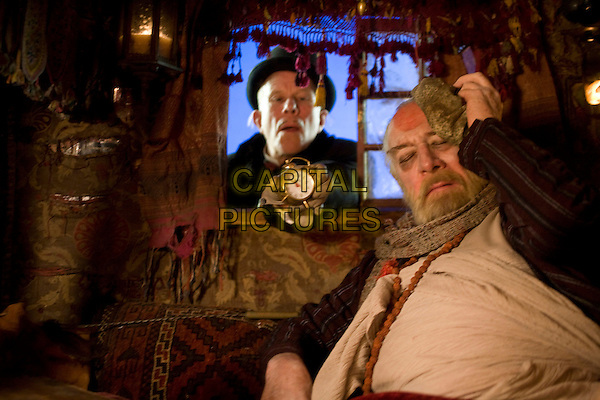 TOM WAITS & CHRISTOPHER PLUMMER.in The Imaginarium of Doctor Parnassus.*Filmstill - Editorial Use Only*.CAP/FB.Supplied by Capital Pictures.