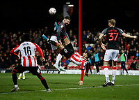 4th January 2020; Griffin Park, London, England; English FA Cup Football, Brentford FC versus Stoke City; Kamohelo Mokotjo of Brentford bicycle kick being blocked by Tom Edwards of Stoke City - Strictly Editorial Use Only. No use with unauthorized audio, video, data, fixture lists, club/league logos or 'live' services. Online in-match use limited to 120 images, no video emulation. No use in betting, games or single club/league/player publications