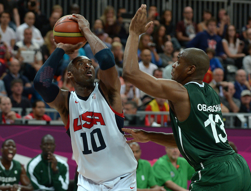USA's Kobe Bryant looks to score a basket while under pressure from Nigeria's Derrick Obasohan..2012 London Olympics - Basketball - Day 7 - Friday 3rd August 2012 - Basketball Arena - Olympic Park - London..