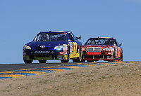 Jun. 21, 2009; Sonoma, CA, USA; NASCAR Sprint Cup Series driver Scott Speed (87) leads Brandon Ash (02) during the SaveMart 350 at Infineon Raceway. Mandatory Credit: Mark J. Rebilas-