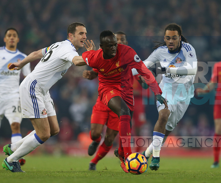 Sadio Mane of Liverpool runs past John O'Shea of Sunderland during the Premier League match at the Anfield Stadium, Liverpool. Picture date: November 26th, 2016. Pic Simon Bellis/Sportimage