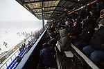 Oldham fans in The George Hill Main Stand watch as play is suspended. Oldham v Portsmouth League 1