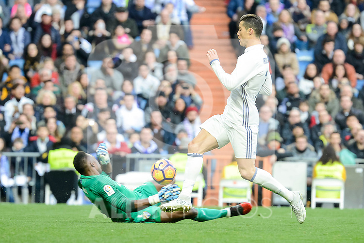 Real Madrid's Cristiano Ronaldo and Malaga CF's Idriss Carlos Kameni during La Liga match between Real Madrid and Malaga CF at Santiago Bernabeu Stadium in Madrid, Spain. January 21, 2017. (ALTERPHOTOS/BorjaB.Hojas)