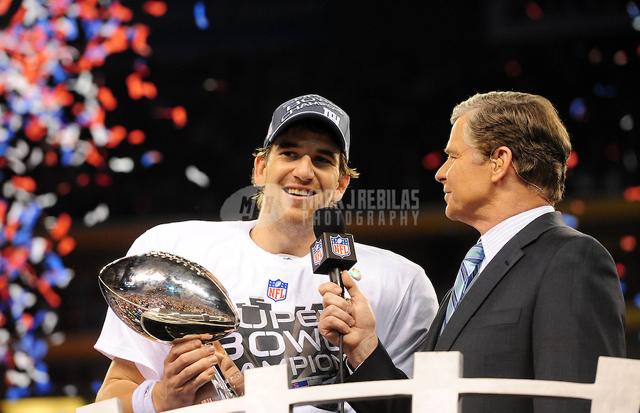 Feb 5, 2012; Indianapolis, IN, USA; New York Giants quarterback Eli Manning holds the Vince Lombardi Trophy as he talks with television personality Dan Patrick after the Giants defeated the New England Patriots 21-17 in Super Bowl XLVI at Lucas Oil Stadium. Mandatory Credit: Mark J. Rebilas-