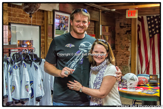 Super Bowl Champions Baltimore Ravens player Morgan Cox signs autographs at the Collierville Dixie Pickers. <br /> Morgan Cox shows off his 80 oz. Super Bowl Ring.
