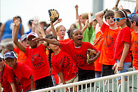 Young fans scream for a Frisbee to be thrown their way during an Education Day day game between the Delmarva Shorebirds and the Kannapolis Intimidators at CMC-Northeast Stadium on April 17, 2013 in Kannapolis, North Carolina.  The Shorebirds defeated the Intimidators 9-4.  (Brian Westerholt/Four Seam Images)