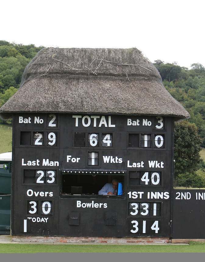 View of the scoreboard at the Wormsley Cricket Club<br /> <br />  (Photo by Kieran Galvin/CameraSport) <br /> <br /> International Cricket - Women&rsquo;s Ashes Test Match - England v Australia - Day 4 - Wednesday 14th August 2013 - Wormsley Cricket Club, High Wycombe<br /> <br /> &copy; CameraSport - 43 Linden Ave. Countesthorpe. Leicester. England. LE8 5PG - Tel: +44 (0) 116 277 4147 - admin@camerasport.com - www.camerasport.com