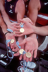 Rowing, celebration, US men's eight, hands show gold medals for winning 1997 FISA World Rowing Championships, Lac Aiguebelette, France, Europe, and calluses from a season of competition,