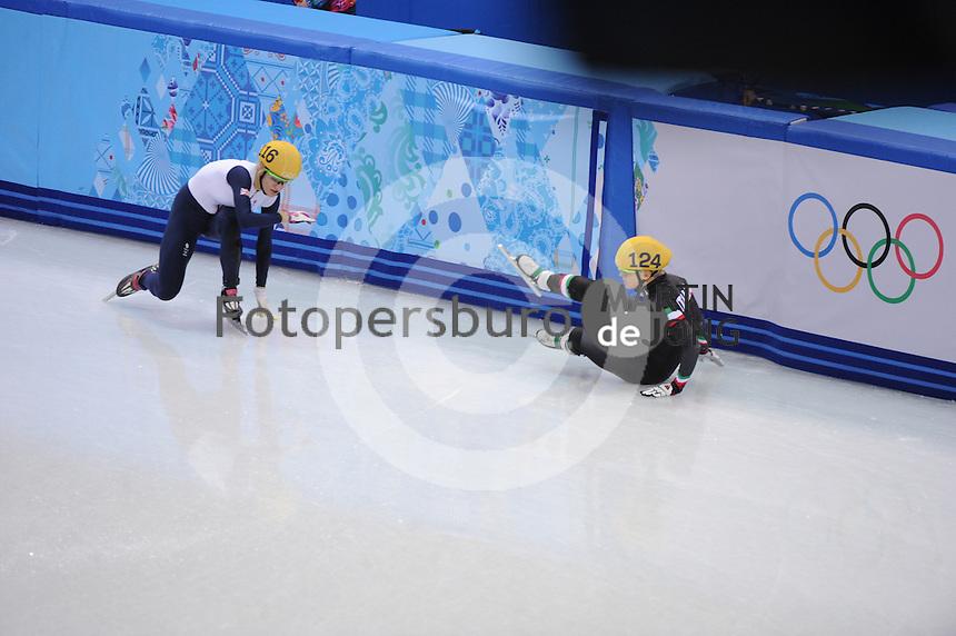 OLYMPICS: SOCHI: Iceberg Skating Palace, 13-02-2014, Shorttrack, 500m Relay Ladies, Finals, Elise Christie (#116   GBR), Arianna Fontana (#124   ITA), ©photo Martin de Jong