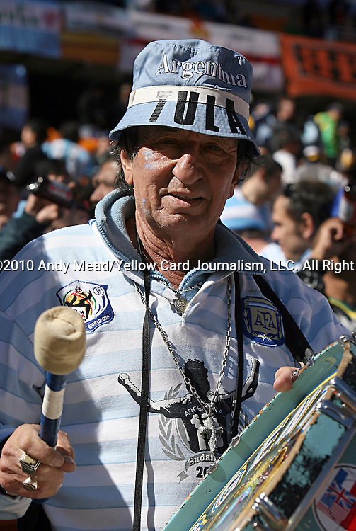 17 JUN 2010:  Argentina fan with drum in the stands.  The Argentina National Team played the South Korea National Team at Soccer City Stadium in Johannesburg, South Africa in a 2010 FIFA World Cup Group E match.