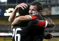 WASHINGTON, DC. - AUGUST 22, 2012:  Chris Pontius (13) of DC United with Lionard Pajoy (26) after Pajoy had scored against the Chicago Fire during an MLS match at RFK Stadium, in Washington DC,  on August 22. United won 4-2.