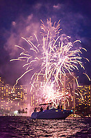 Tourists enjoying the view of Waikiki's Friday night fireworks on a speedboat off of O'ahu.