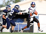 HARTFORD, SD - AUGUST 30:  Justin Boll #48 and Brayden Swartwout #42 from West Central chases down Isaac Faldmo #10 from Dakota Valley during the first quarter of their game Friday night at West Central. (Photo by Dave Eggen/Inertia)