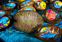 Decorated coconuts for sale and mail at a roadside stand on the way to Hana, Maui.