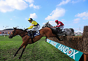 14h April 2018, Aintree Racecourse, Liverpool, England; The 2018 Grand National horse racing festival sponsored by Randox Health, day 3; Harry Skelton leads Shantou Rock over a fence on the first circuit in The Doom Bar Maghull Novices' Steeple Chase