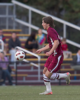 Harvard University forward Brian Rogers (11) brings the ball forward. Boston College defeated Harvard University, 2-0, at Newton Campus Field, October 11, 2011.